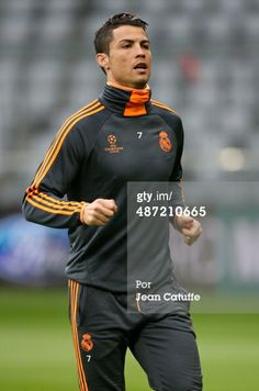 Cristiano Ronaldo of Real Madrid warms up during the training session on the eve of the UEFA Champions League semi final second leg match between FC Bayern Muenchen and Real Madrid CF at Allianz Arena on April 28, 2014 in Munich, Bavaria, Germany. (Photo by Jean Catuffe/Getty Images)