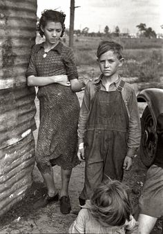 """January 1937. """"Part of the family of a migrant fruit worker from Tennessee, camped near the packinghouse in Winter Haven, Florida."""" View full size. 35mm nitrate negative by Arthur Rothstein for the Farm Security Administration."""