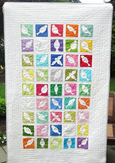 Cute!  Love the bright solid colors.  What's appliqued, though?  The birds or the background?