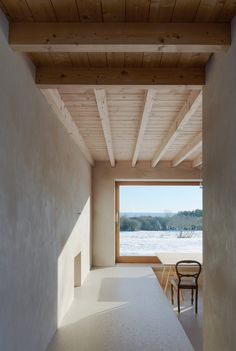 Hung onto the similarly mottled walls of the building's exterior, the windows are intended to reference the type of openings usually found in barns.