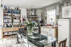 funky eclectic cabin kitchen, eat in dining room, barn wood walls, freestanding kitchen cabinets, open shelving