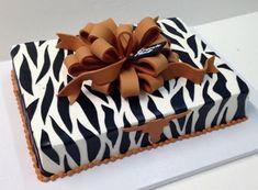 Zebra stripe gift box cake with University of Texas Longhorn symbol.JPG