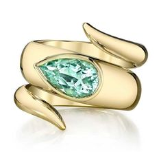 Erica Courtney green tourmaline wrap ring in gold. Via thejewelryeditor.com