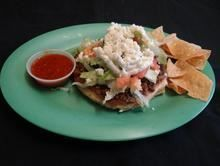 Sope :Handmade tortilla with beans, lettuce, tomato, onions, cilantro, ranchero cheese, sour cream, guacamole and hot salsa with your choice of meat from Pico Pica Rico Restaurant in Los Angeles #Food #Sope #Restaurant forked.com