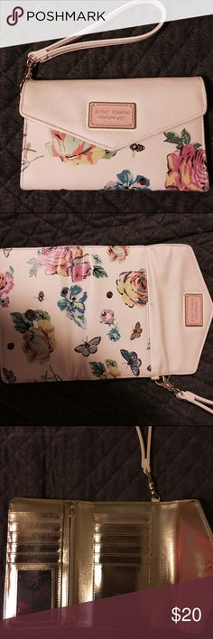 wallet/wristlet Cute Betsy Johnson wristlet/wallet.  Cream colored with pretty butterfly details.  Holds all your money and cards.  Don't feel like lugging around your bag while shopping or a note on the town, just grab your wallet and start your shopping!!  Lol betsy johnson Bags Wallets