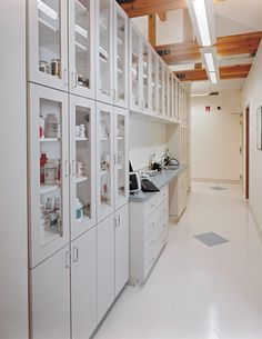 PHarmacy cabinets / desk -- backside of treatment island.