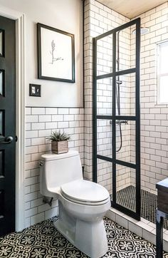 Black and White Guest Bathroom in Modern Farmhouse Renovation. FEATURED: Gridscape Series Factory WIndow Shower Screen with True Divided Light Construction, Black Frame and CLear Glass. Coastal Shower Doors -Design To Define