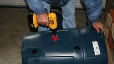 Drill a hole in the side of your garbage can for easier full-bag removal.