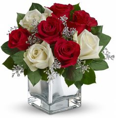 The perfect Christmas hostess gift, this exciting bouquet of red and white roses in a dazzling cube is guaranteed to make spirits brighter. Simple, stylish, affordable...better order one for yourself as well!