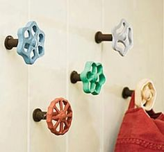 Water valve knobs as hooks, dresser/cabinet knobs, art... could they ever be incorporated as doorknobs? Have seen them as perches on birdhouses, too. Ideas?
