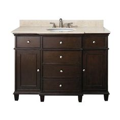 "The Windsor 48"" vanity is a beautiful transitional design with classic lines. Constructed of solid wood and veneers, brushed nickel hardware, soft-close drawer guides and hinges.   	Two soft-close doors and five soft-close drawers 	Adjustable height levelers 	Under counter sink application 	Counter top, sink, and faucet not included"
