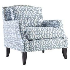 "Bring eye-catching style to your living room or master suite with this bold arm chair, showcasing trellis-print upholstery and a wood frame.  Product: ChairConstruction Material: Cotton and woodColor: Blue and espressoFeatures:  Camel backNailhead trim Track arms Tapered legs Loose pillow back  Dimensions: 35.75"" H x 30"" W x 34"" DNote: Ottoman is not includedAssembly: Assembly required"