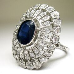 Period: Art deco (1920-1935) Composition: Platinum Stones: - 1 natural oval cut sapphire that weigh 1.50ctw. - 45 Old mine cut diamonds of H-VS2 quality that weigh 1.20ctw. Ring size: Ring Face: 26mm