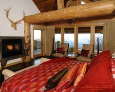 Bedroom in post and beam home in North Carolina.  For more photos or this or any other or my homes, please check out my website, www.designma.com, my Design Page, www.facebook.com/loghomedesign, or Pinterest, http://www.pinterest.com/murrayarnott/murray-a