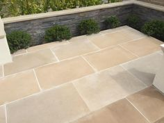 Abbey Sawn Sandstone paving has gorgeous beige and buff tones, with a grey tinge that makes it perfect for traditional settings.