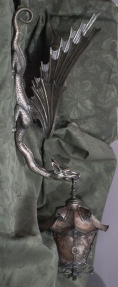 Bronze, Copper and Mica Dragon Sconce and Wall light bracket. Circa 1890.