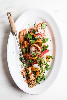 Think peas, mint, pistachios and carrot tops, all blending together to make one vibrant and earthy pesto. That& what is spooned on this roasted salmon and just like that dinner is done!