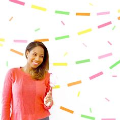 Create a confetti photo backdrop for your next party! Cut strips of cardstock and tape them to twine. Drape it across your wall for some photo fun!   via Spark & Chemistry