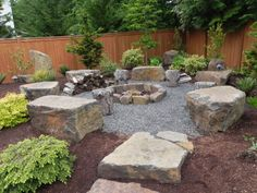 Sammamish fire pit with boulder seating
