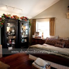 Christmas garland over cabinet in bedroom