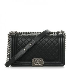 This is an authentic CHANEL Caviar Quilted Medium Boy Flap in Black. This stylish shoulder bag is crafted of luxurious caviar leather in black. The bag features a ruthenium chain shoulder strap with a leather shoulder pad, a diamond-quilted crossover flap with a linear quilted border, and a ruthenium CC boy lock. This opens to a black fabric interior with a flat pocket. This is an ideal shoulder bag for any occasion, from Chanel!