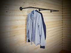 Wall mounted clothes rack / clothes rail / garment rack. Will fit both into rustic and industrial interiors. Hand made especially for you! Pipe and fittings are fully degreased and covered with several layers of mat lacquer to maintain their look and stop from smear. Rod distance