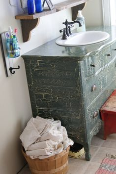 Inspiration from Bathrooms.com: Just when you thought paint effects were dead and buried... We've got news for you - they're making a comeback. We're liking the crackleglaze on this vanity unit. - kids bath with stickers on countertop