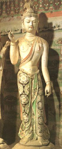 clay Bodhisattva Dunhuang, ca. 800  CE. The Tang Dynasty saw growth and prosperity where  Buddhist beliefs, temples, and art permeated almost all levels of life. This sculpture reflects the wealth of the great Buddhist monasteries decorated in rich clothing painted in lush colors.  5 ft 3 inch.