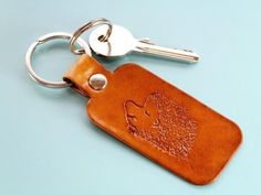 > Who does not love hedgehogs? This hand-carved leather keyring would make an excellent leather gift Leather Bookmark, Leather Keyring, Leather Gifts, Leather Craft, Handmade Leather, Gifts For Pet Lovers, Gifts For Mum, Gifts For Friends, Leather Anniversary Gift