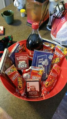 Work Gift Exchange - Entertainment Basket -Under $10 - Soda, popcorn, crackers, cards, dice, and a movie.