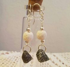 Check out this item in my Etsy shop https://www.etsy.com/listing/479342614/troca-shell-and-white-lava-bead-dangle
