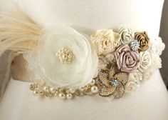 Bridal Sash with Organza and Satin Flowers, Ostrich Plumes, Czech Pearls and Brooches. $195.00, via Etsy.