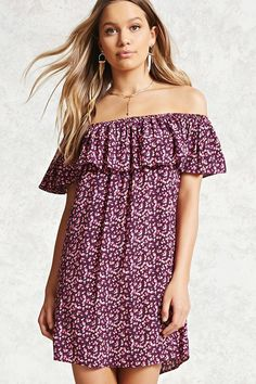 A woven dress featuring an allover floral pattern, elasticized off-the-shoulder neckline, a flounce layer, short sleeves, and a billowy silhouette.