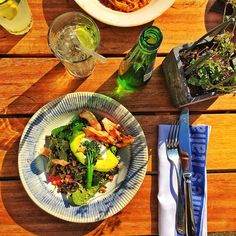 Jamie Oliver's! The best thing to ever happen to this country's health. May I present the Superfood Salad: Grilled avocado candied beets pulses grains sprouted broccoli pomegranate toasted seeds and Harissa with wild caught salmon. With a drink of ginger and lemongrass press. #jamieoliver #jamieoliversitalian #jamieoliverrestaurant #avocadolove #harissa #pomegranate #superfood #wildcaught #glutenfree #healthystaceyinbritain #healthystaceyblog