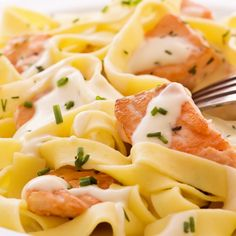 Salmon tagliatelle served with a creamy wine sauce and chives.. Salmon Tagliatelli Recipe from Grandmothers Kitchen.