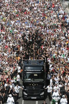 Thousands of Germany fans line the streets as the national football team makes its way thr...
