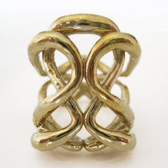 The elegant Sloris 'One Infinity Ring' twists and turns, bends and bows around your finger. Jewelry designs using the simple figure eight infinity