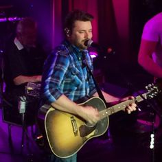 Chris Young singing his latest hit at CRS in Nashville. He is coming to The Farm Bureau Live with Dierks Bentley May Tix still on sale Latest Hits, Nashville News, He Is Coming, Dierks Bentley, Chris Young, Country Artists, Singing, Guitar, Live