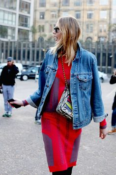 A denim jacket on the streets of London instantly gives a relaxed vibe to this printed dress.