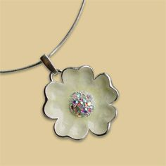 """Lena Pendant. colorful Cherokee Rose design from the Cherokee Rose Collection in brilliant sterling silver finish. Each piece of this magnificent collection celebrates the 1,200 mile journey of hardship traveled by the Cherokee in 1838, known as the Trail of Tears. Lovingly hand-painted in gentle Yellow enamel. Sterling silver-plated with matte finish & dazzling crystals accent the center of the rose. measures 1½"""" in diameter on a ½"""" bail. Snake chain is 16"""" long with lobster claw clasp. Cherokee Language, Cherokee Rose, Trail Of Tears, Native American Beauty, My Heritage, Rose Design, Clay Beads, Native Americans, Turquoise Jewelry"""