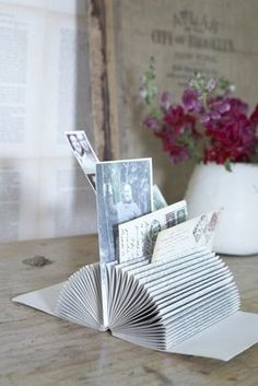 Letter rack from an old book.  Love this recycling.