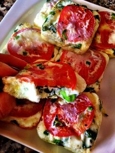 Tomato, basil & spinach egg muffins! Put fresh, chopped basil, green onion, spinach & 1 tomato slice in bottom of muffin tin sprayed with Pam. Pour egg whites mixed w/ garlic powder & pepper over veggies to top of each cup. Bake 10-15 minutes at 350.