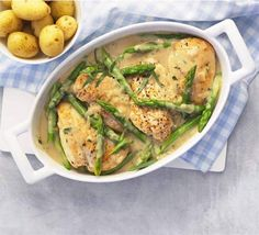 Creamy chicken with asparagus & tarragon. A light and low-calorie chicken casserole with silky herb sauce, greens and baby new potatoes.
