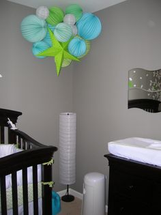 gray walls, espresso crib, accent colors