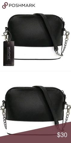 """Brand new! Black Crossbody Bag Black Crossbody Bag Brand new in pkg. 6x5x3"""" Long crossbody strap chain w pu leather at top. Pu leather. White stripe at bottom in front not at back so you can wear either way. Bags Crossbody Bags"""