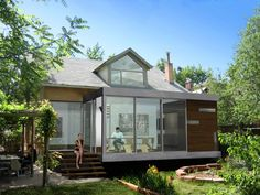 This modern plug-on to an early 20th century bungalow in Denver's Highland neighborhood connects the house to a formal herb and flower garden. The addition contrasts a very open, public dining space with an opaque, private bar and powder room. The dining space completely transforms seasonally into an open-air porch.