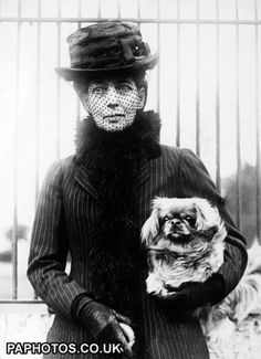 British Royalty - Queen Alexandra and dog - 1923; She was consort to King Edward VII, who was son and successor to Queen Victoria.  Alexandra had a hearing impairment and had to put up with a lot infidelity in her marriage!