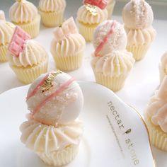 Cupcakes   Macarons =  #Padgram