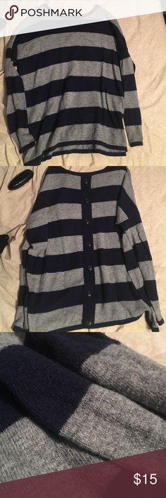 Striped sweater This sweater is warm and comfortable, and has only been worn a couple of times. The stripes are gray and dark blue. Necessary Clothing Sweaters Crew & Scoop Necks