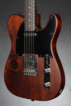 Fender's special edition Reclaimed Eastern Pine Telecaster Electric Guitar has a distinctively rustic look and elegant charm, with a body fashioned from reclaimed pine originally used in 1868 in the construction of a dairy barn in the small rural community of Lake Odessa, Mich. The knots, gashes, dings and other anomalies in the wood are left intact and unconcealed, so that no two guitars in this limited-number issue are identical.